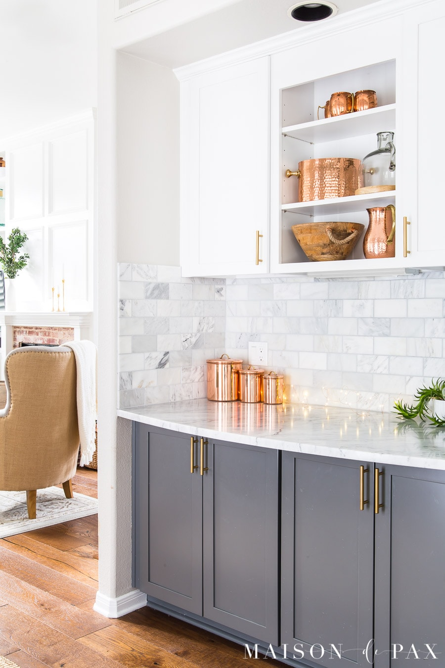 Agreeable Gray walls with white and gray cabinets and cararra marble tile and countertops | Maison de Pax