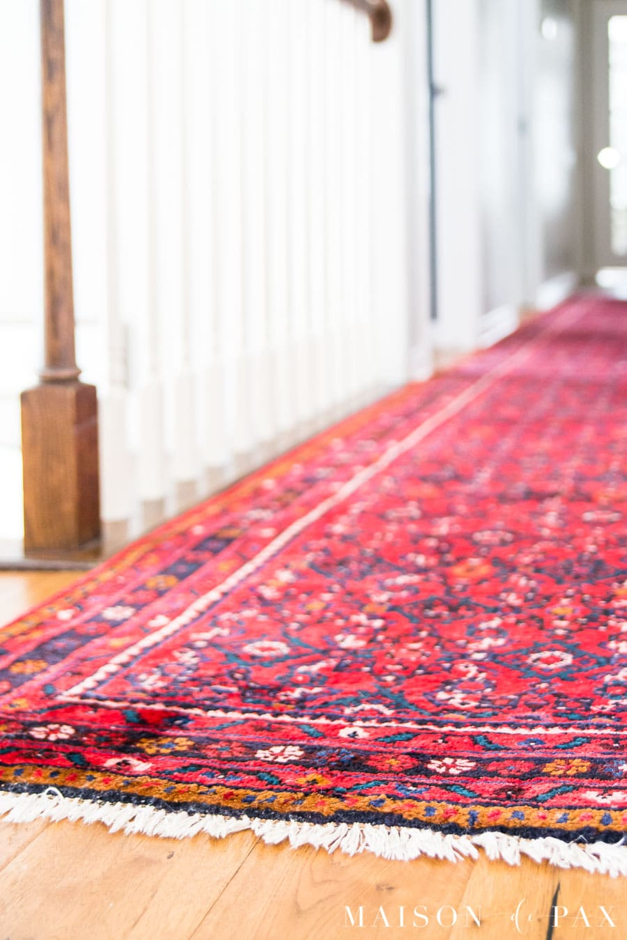 red, blue, and orange vintage Persian rug runner