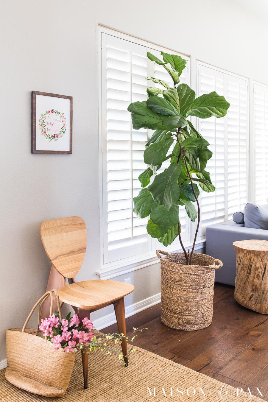 wooden chair with watercolor print above and fiddle leaf fig | Maison de Pax