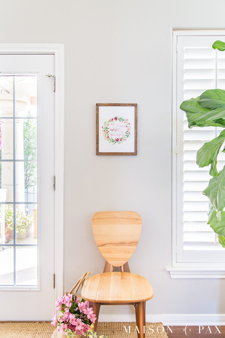 light wood chair with watercolor wall art above | Maison de Pax