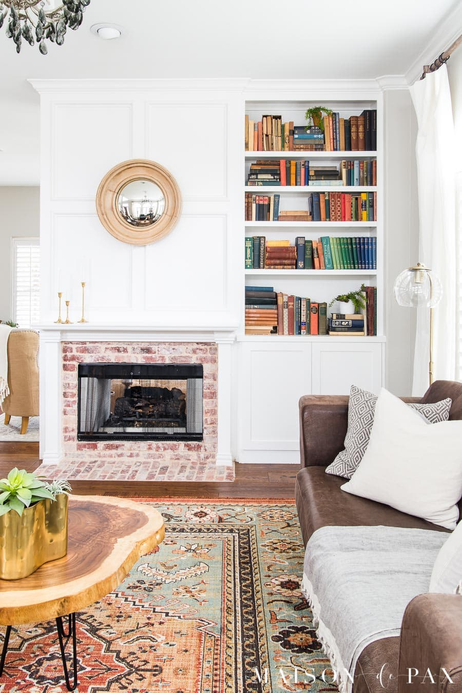 living room fireplace and bookcase with antique books | Maison de Pax