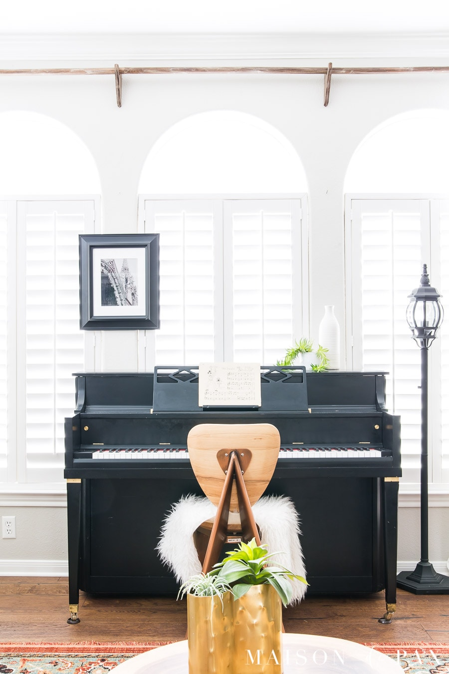 black and brass mid century piano | Maison de Pax