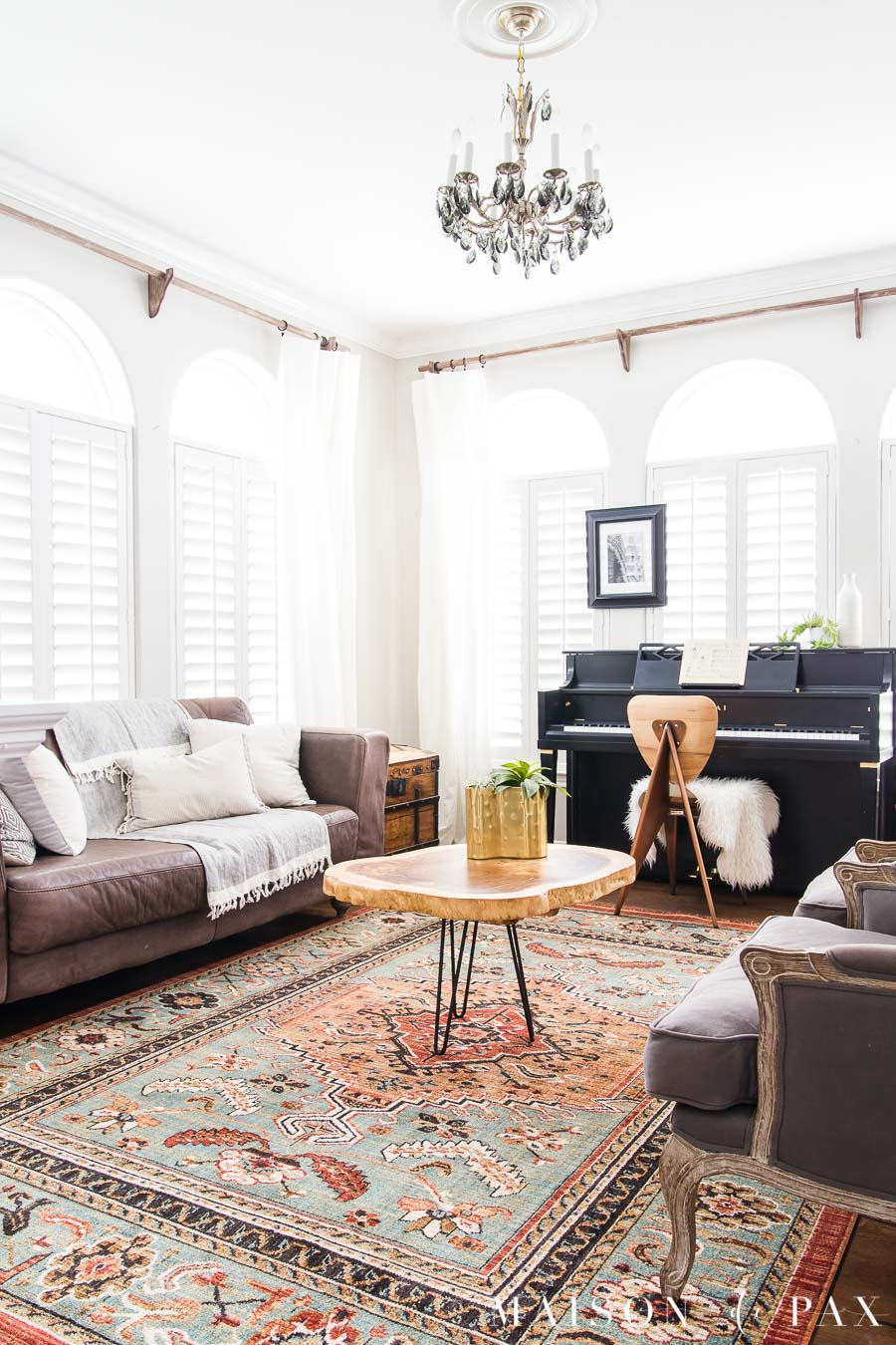 traditional boho chic living room with brown leather sofa | Maison de Pax