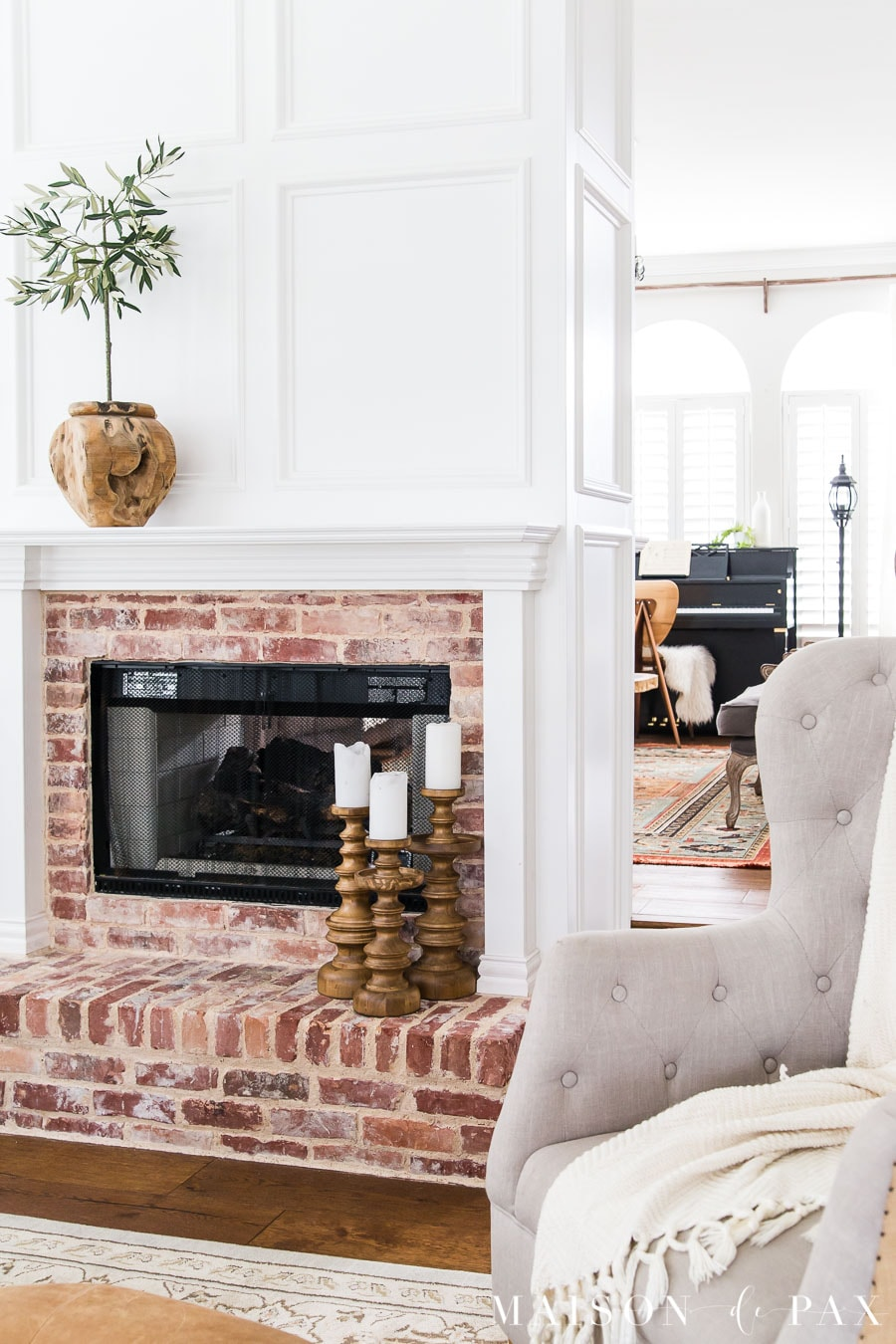brick fireplace with white wood molding | Maison de Pax