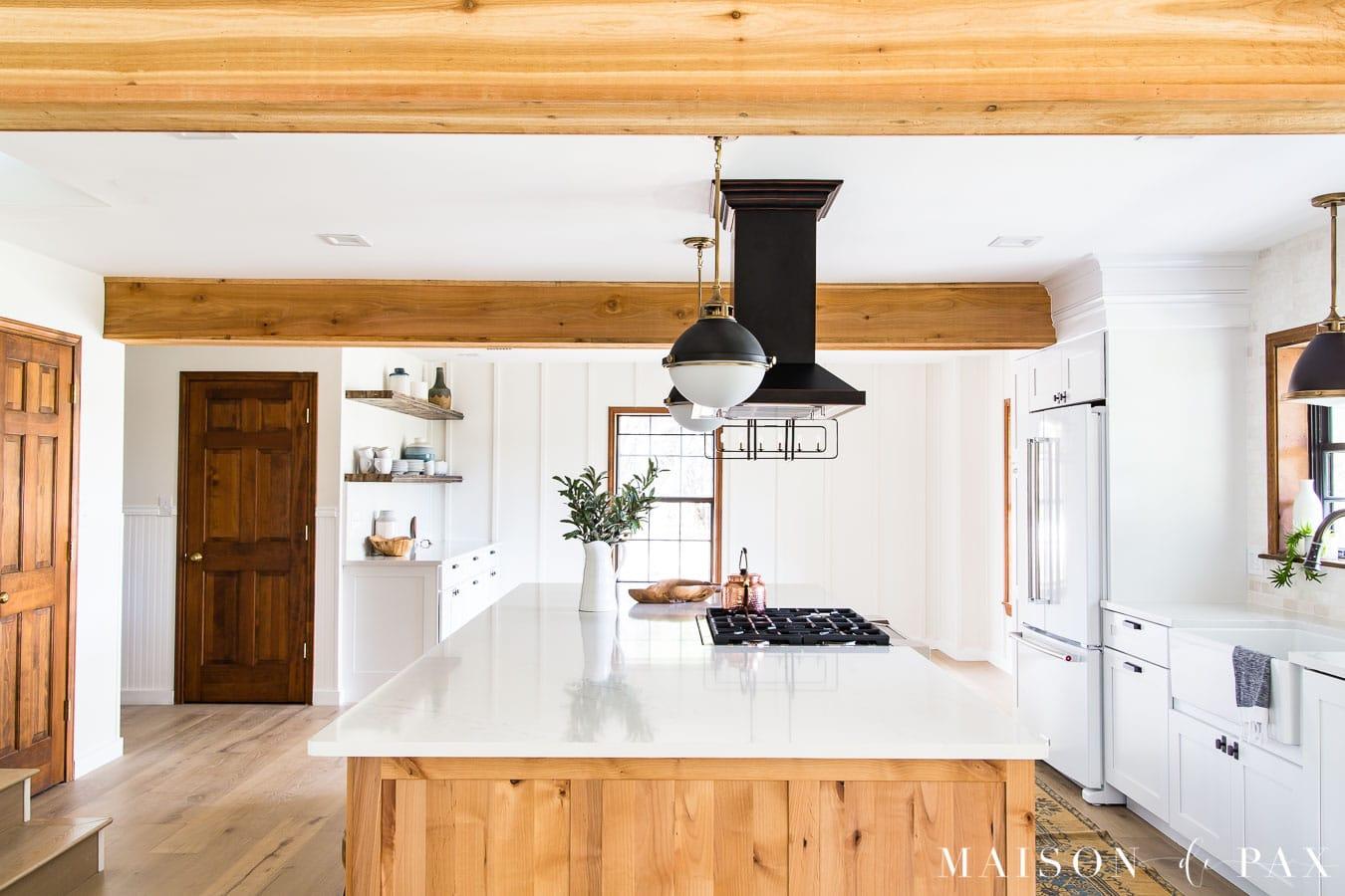 rustic cedar beams and rustic alder kraftmaid island cabinets | Maison de Pax