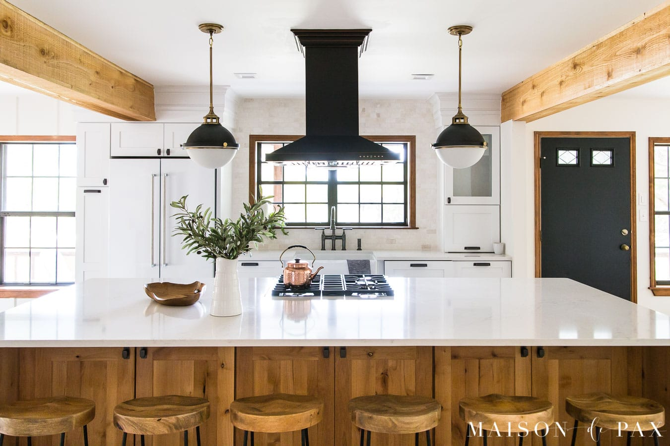 big wood island kitchen black and white lighting | Maison de Pax