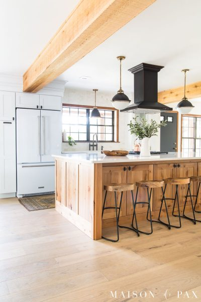 big island kitchen with white fridge | Maison de Pax