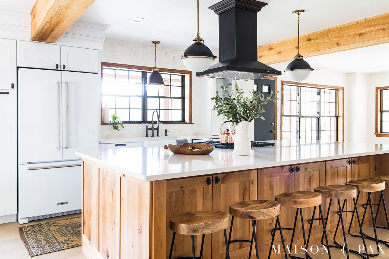 giant wood island in kitchen with barstools | Maison de Pax