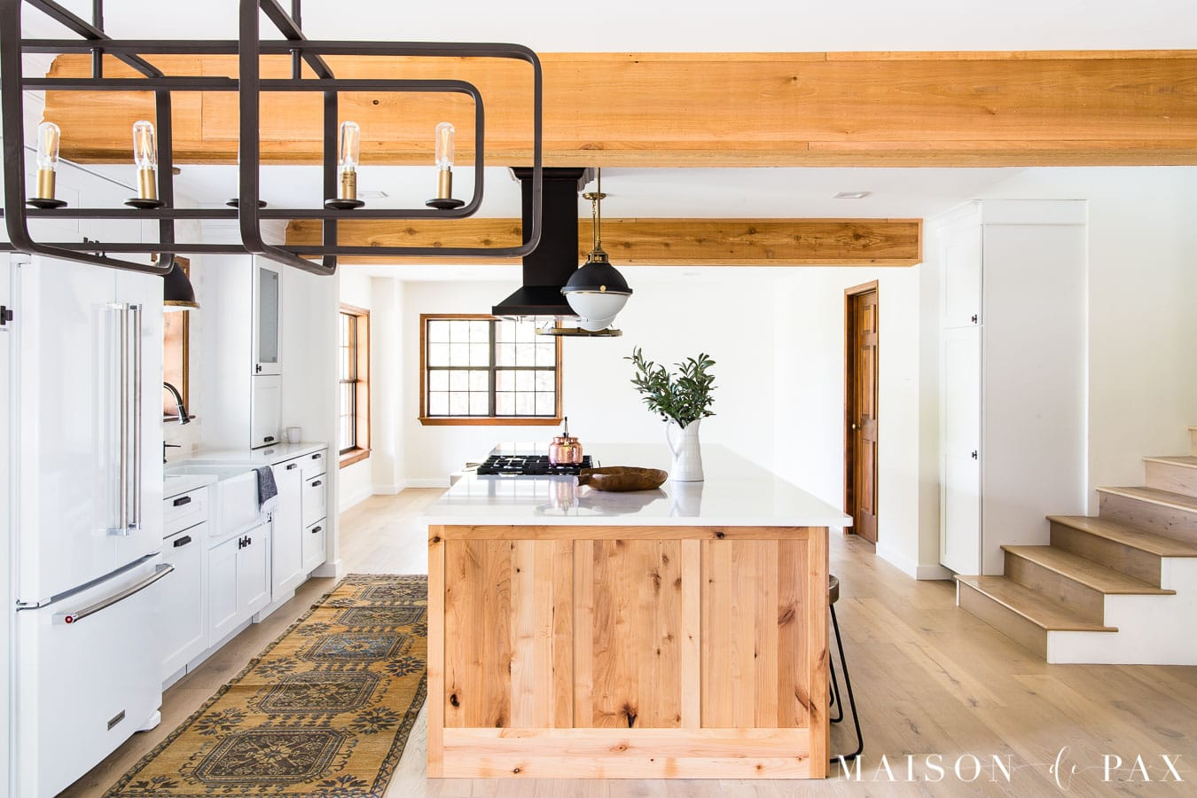 big rustic wood island in kitchen with beams | Maison de Pax