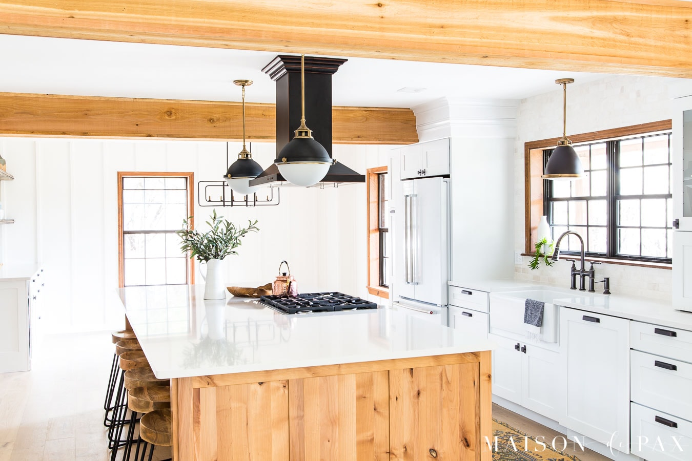 rustic cedar beams and rustic alder island in modern farmhouse kitchen | Maison de Pax
