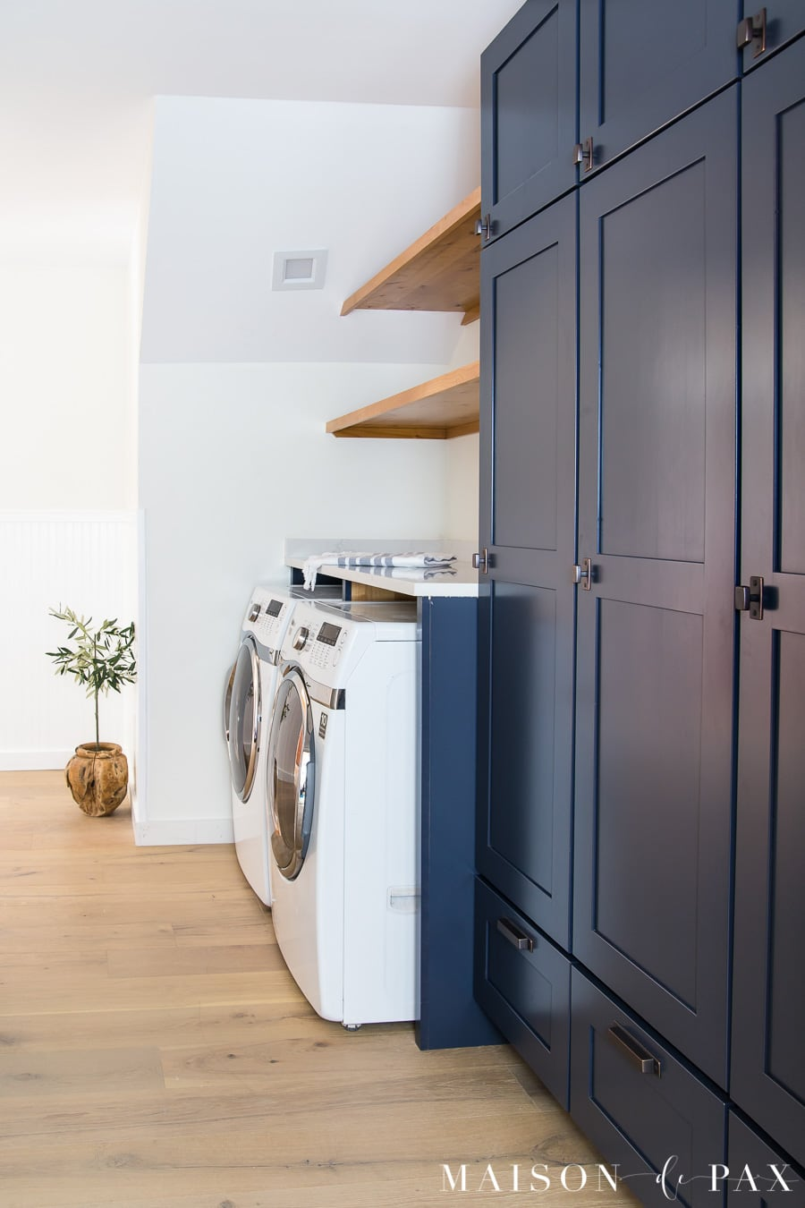 navy and white laundry room with wood shelves | Maison de Pax