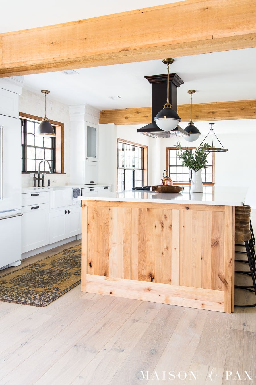 rustic wood island with white quartz kitchen counters | Maison de Pax