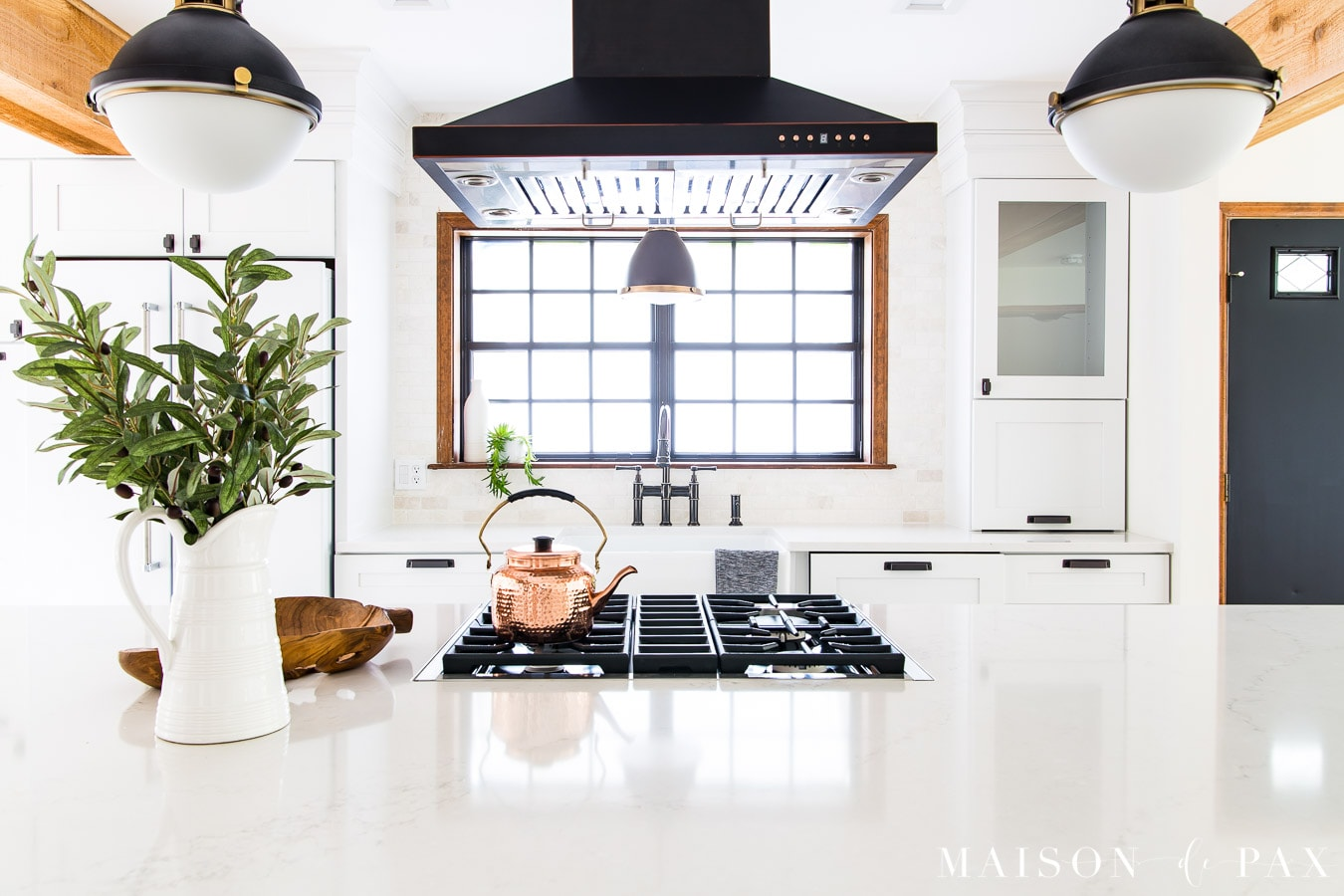 white marble-look quartz countertops on large kitchen island | Maison de Pax