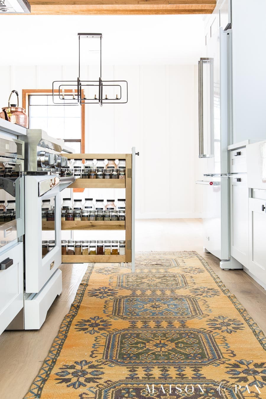 organized spice pull out beside stove modern farmhouse kitchen | Maison de Pax