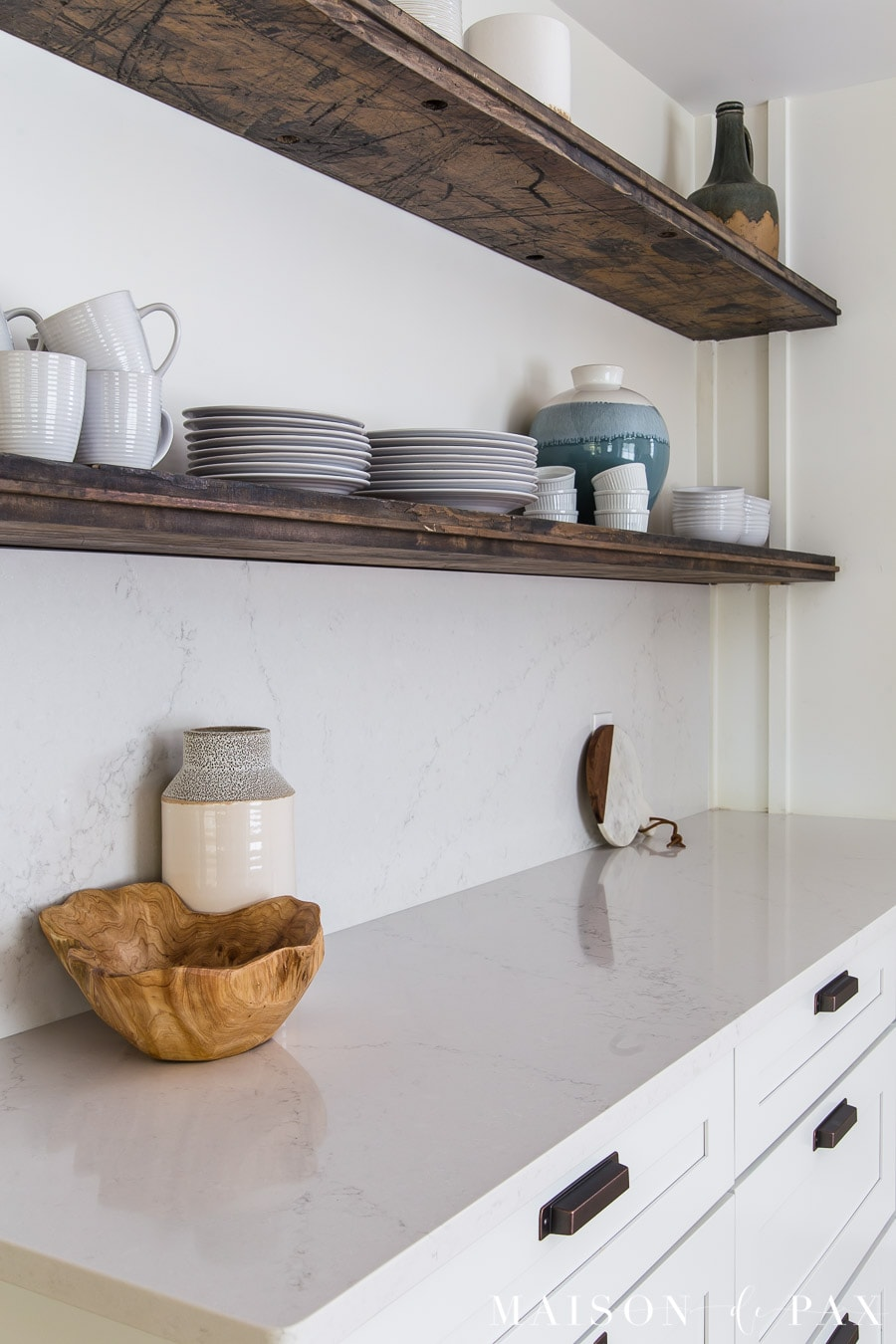reclaimed wood floating shelves above quartz kitchen counters | Maison de Pax
