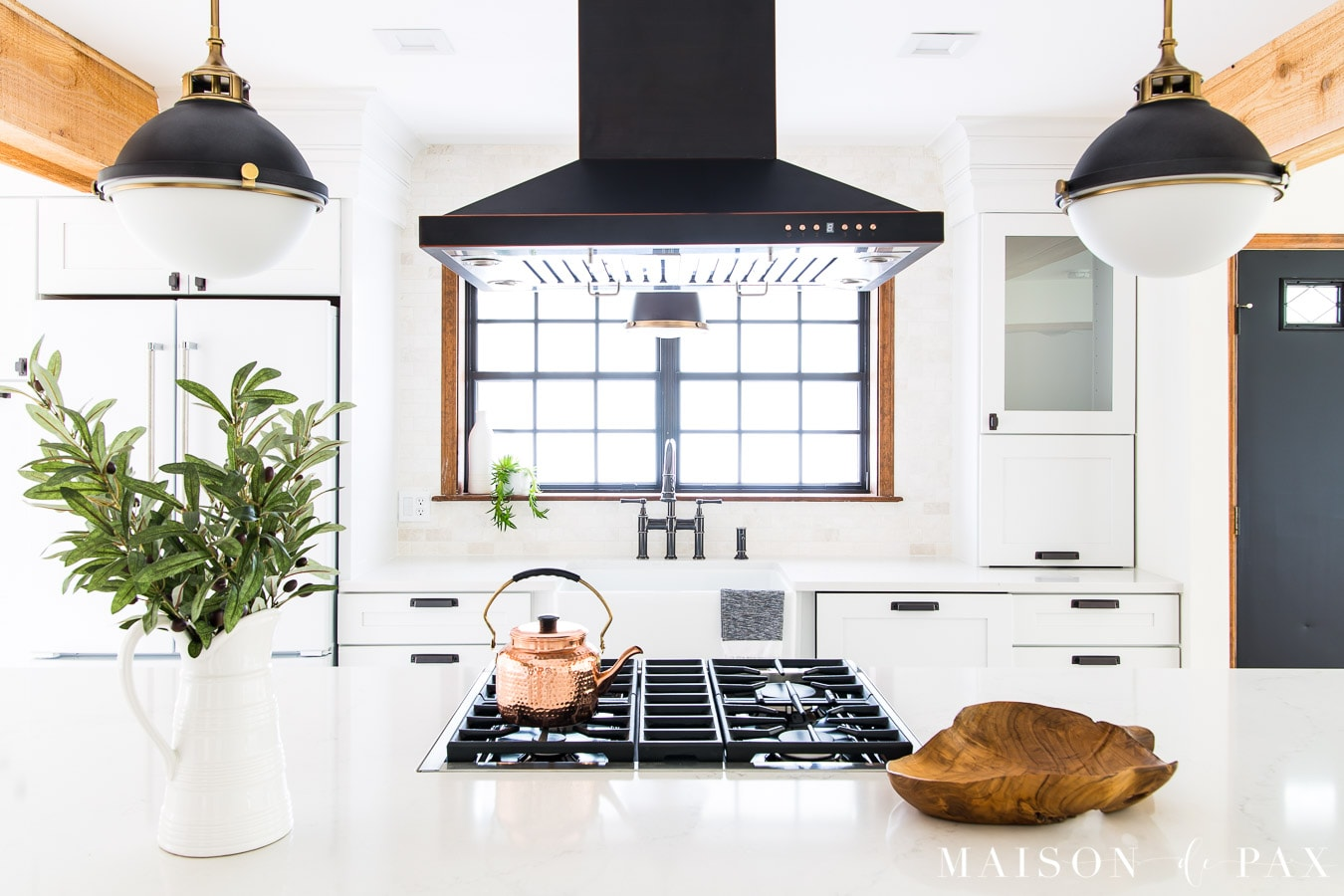 black and white globe lights over kitchen island | Maison de Pax