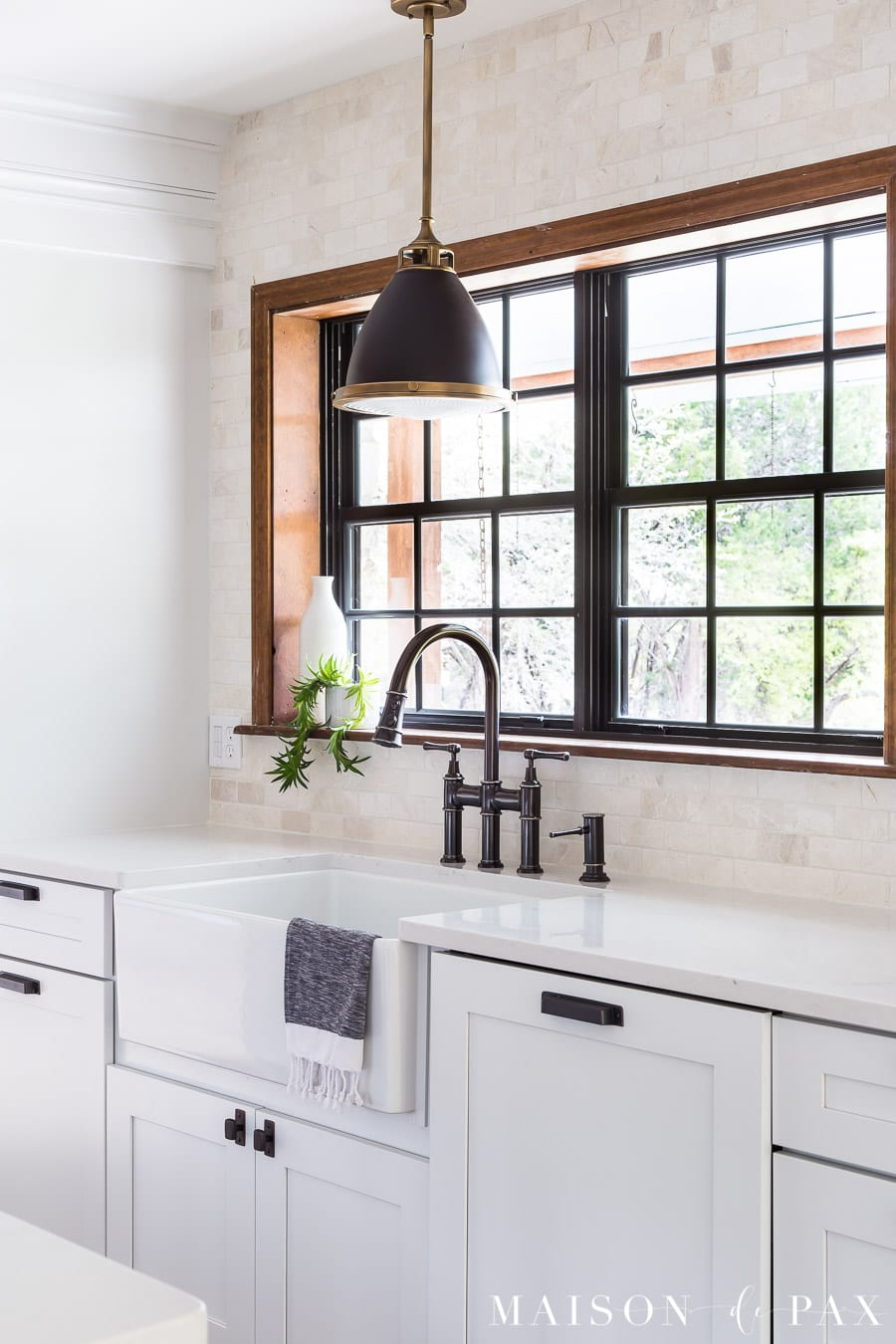 black and brass pendant over farmhouse sink | Maison de Pax