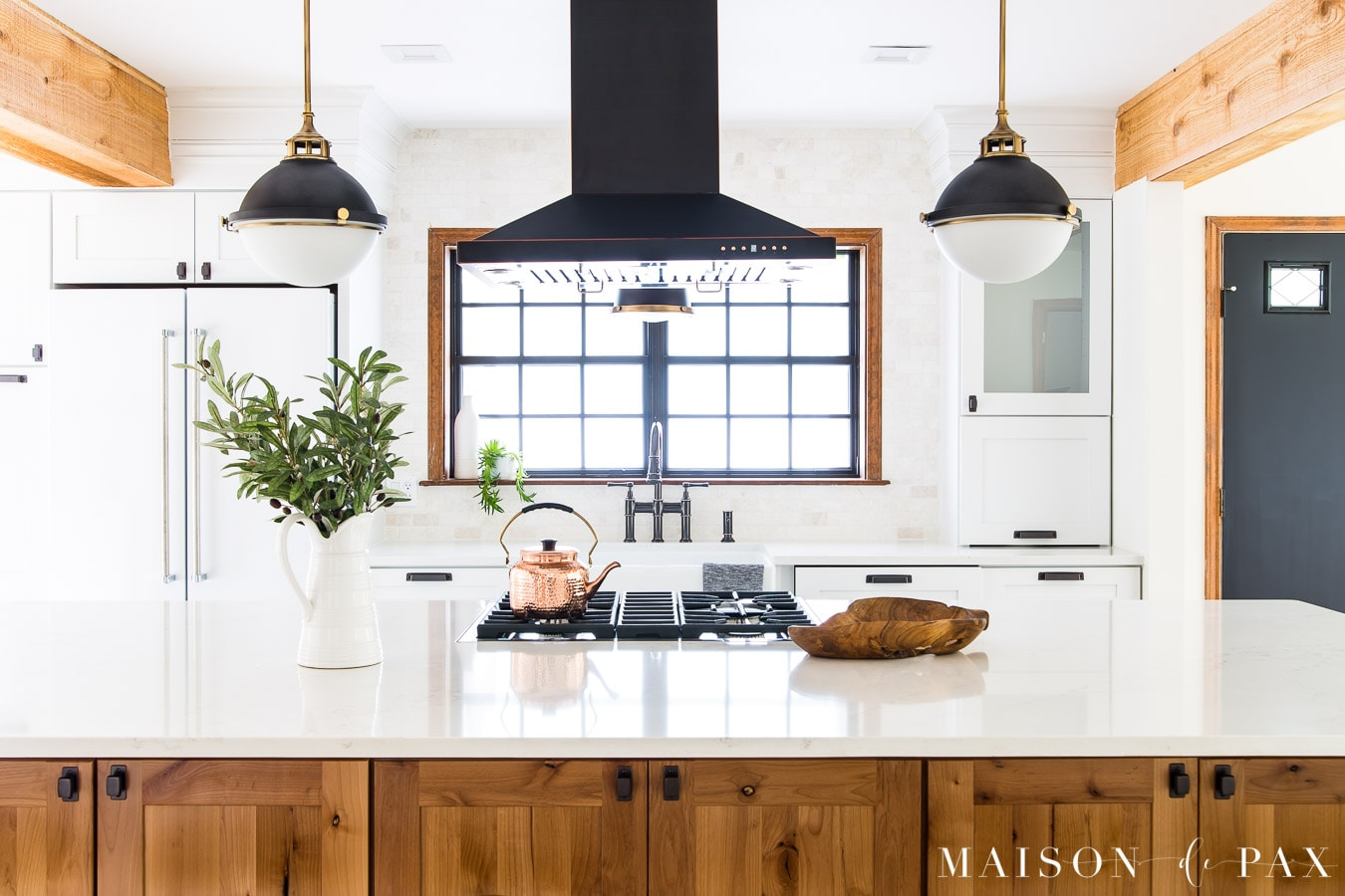 wood island with white quartz countertops kitchen | Maison de Pax