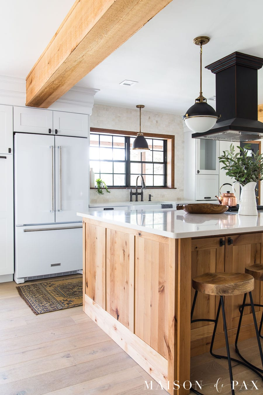 white fridge, rustic beams, wood island in kitchen | Maison de Pax