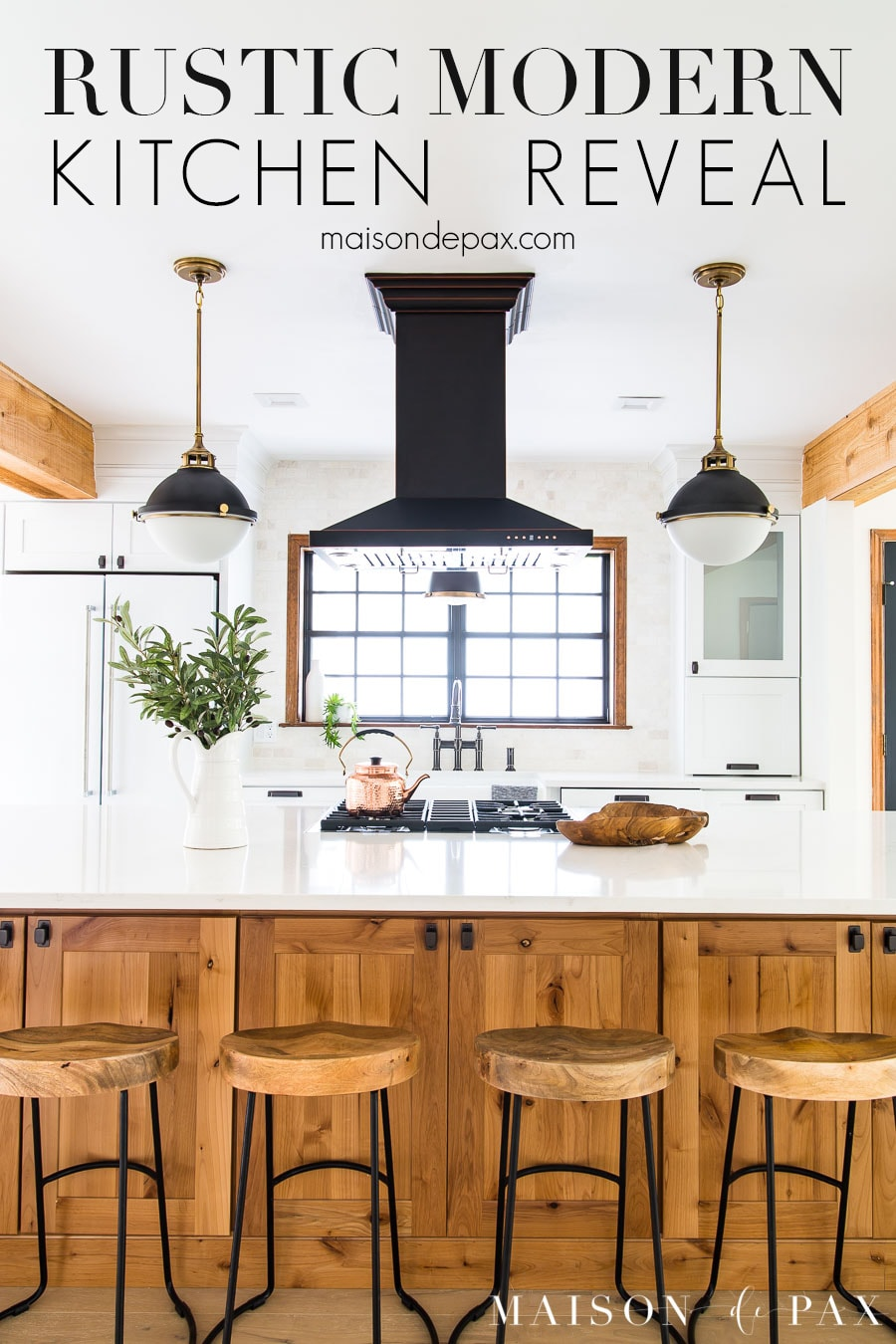 big wood island kitchen with white counters and black accents