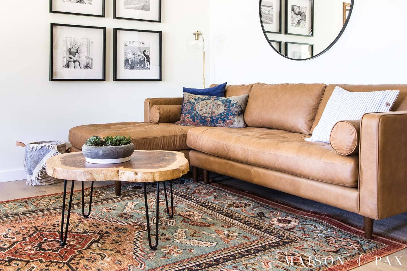 tan leather sofa with log slice coffee table with black metal hairpin legs | Maison de Pax