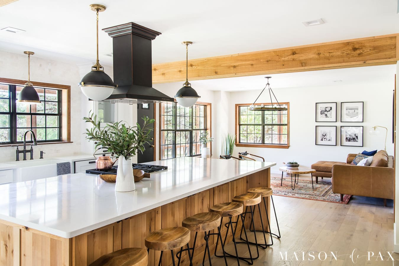 big island open kitchen with rustic mid century modern living room beyond | Maison de Pax