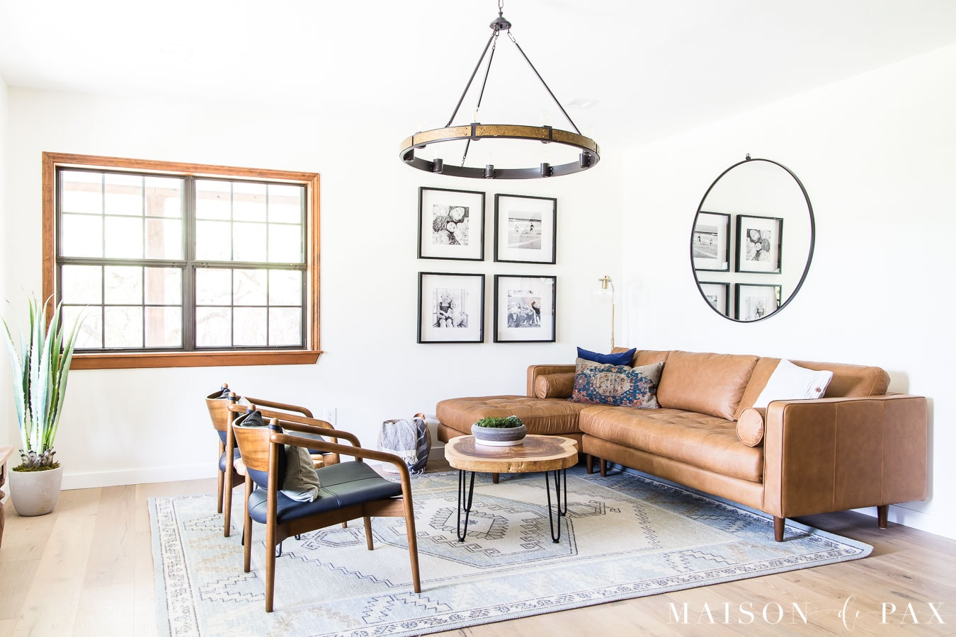 gallery wall, wagon wheel chandelier, modern farmhouse living room | Maison de Pax
