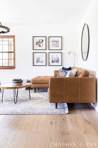 light blue rug with tan leather sectional sofa | Maison de Pax