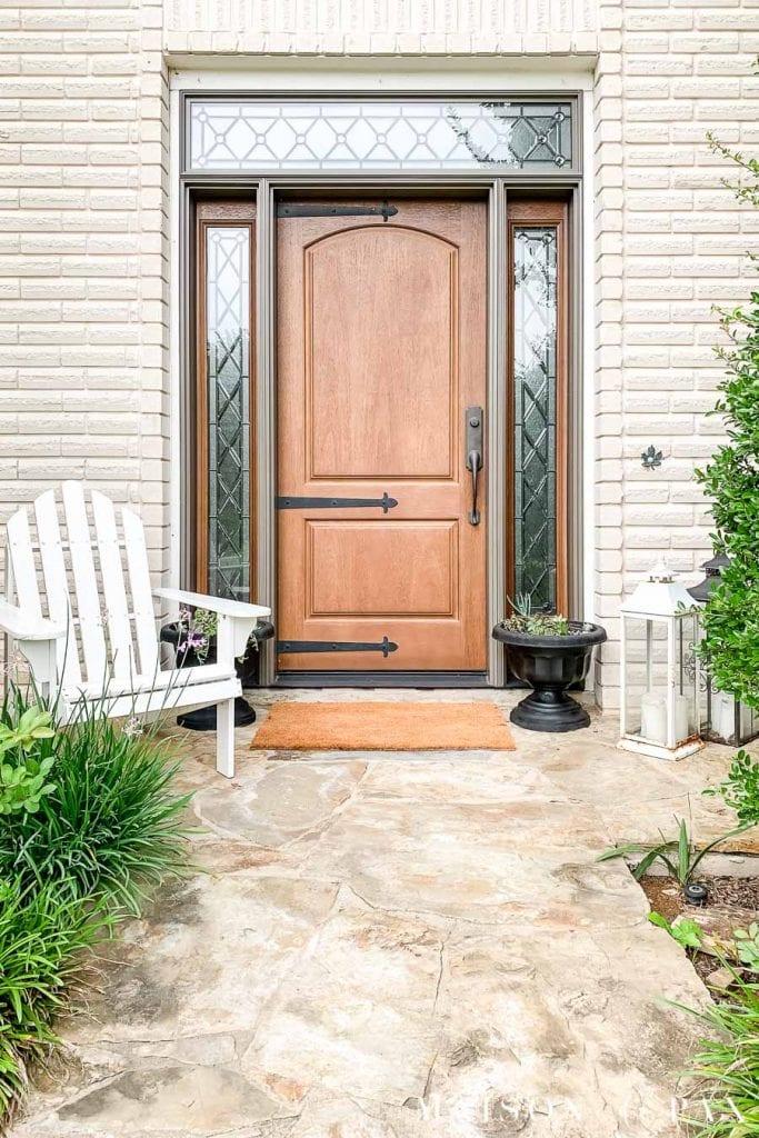 off white front porch with wood door and black succulent planters | Maison de Pax