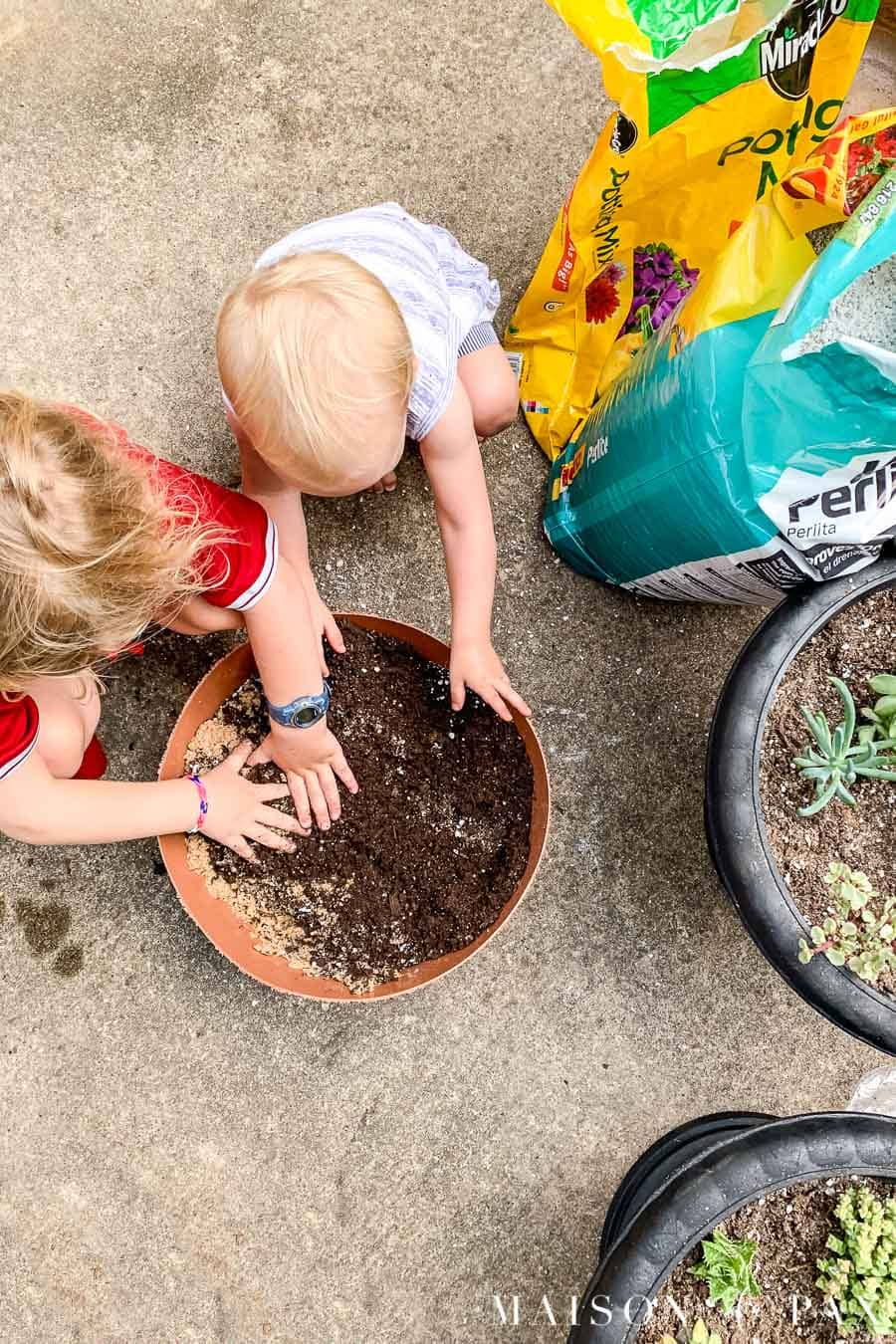 girls mixing potting soil for succulents | Maison de Pax