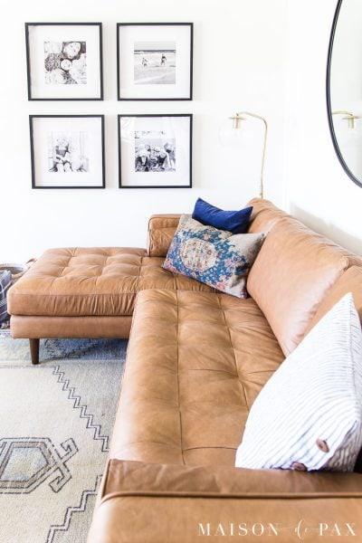 caramel leather sofa with throw pillows | Maison de Pax