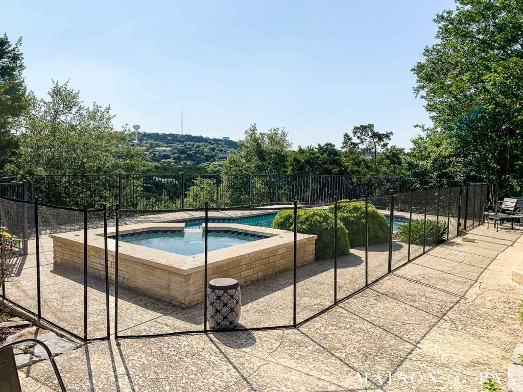 large cream colored deck and light blue pool | Maison de Pax