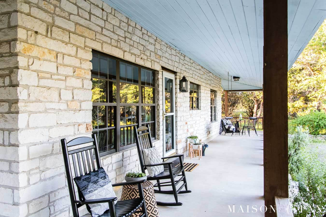 charming farmhouse porch with black rocking chairs and porch swing   Maison de Pax