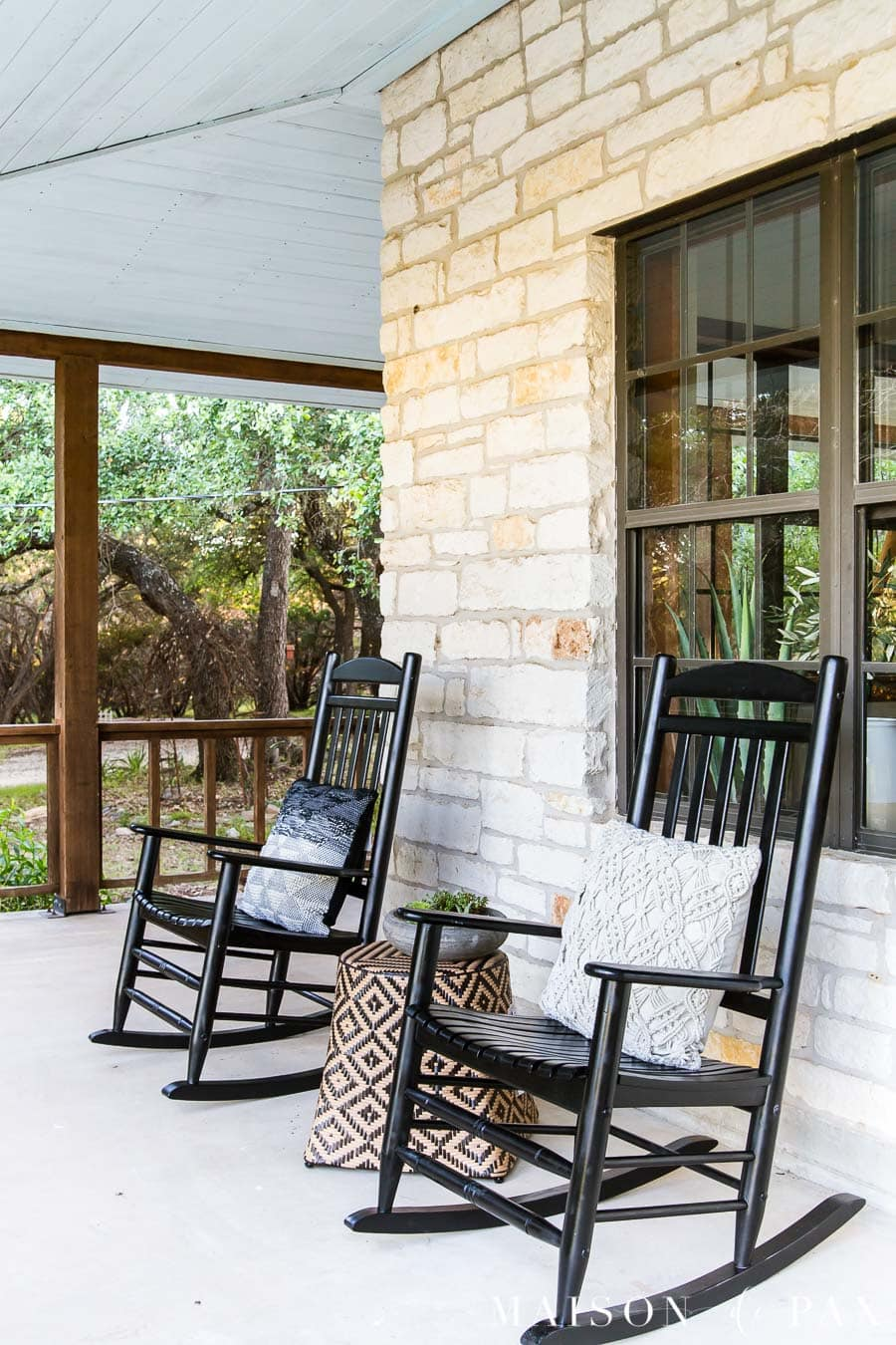 black wooden rocking chairs on Austin stone front porch | Maison de Pax