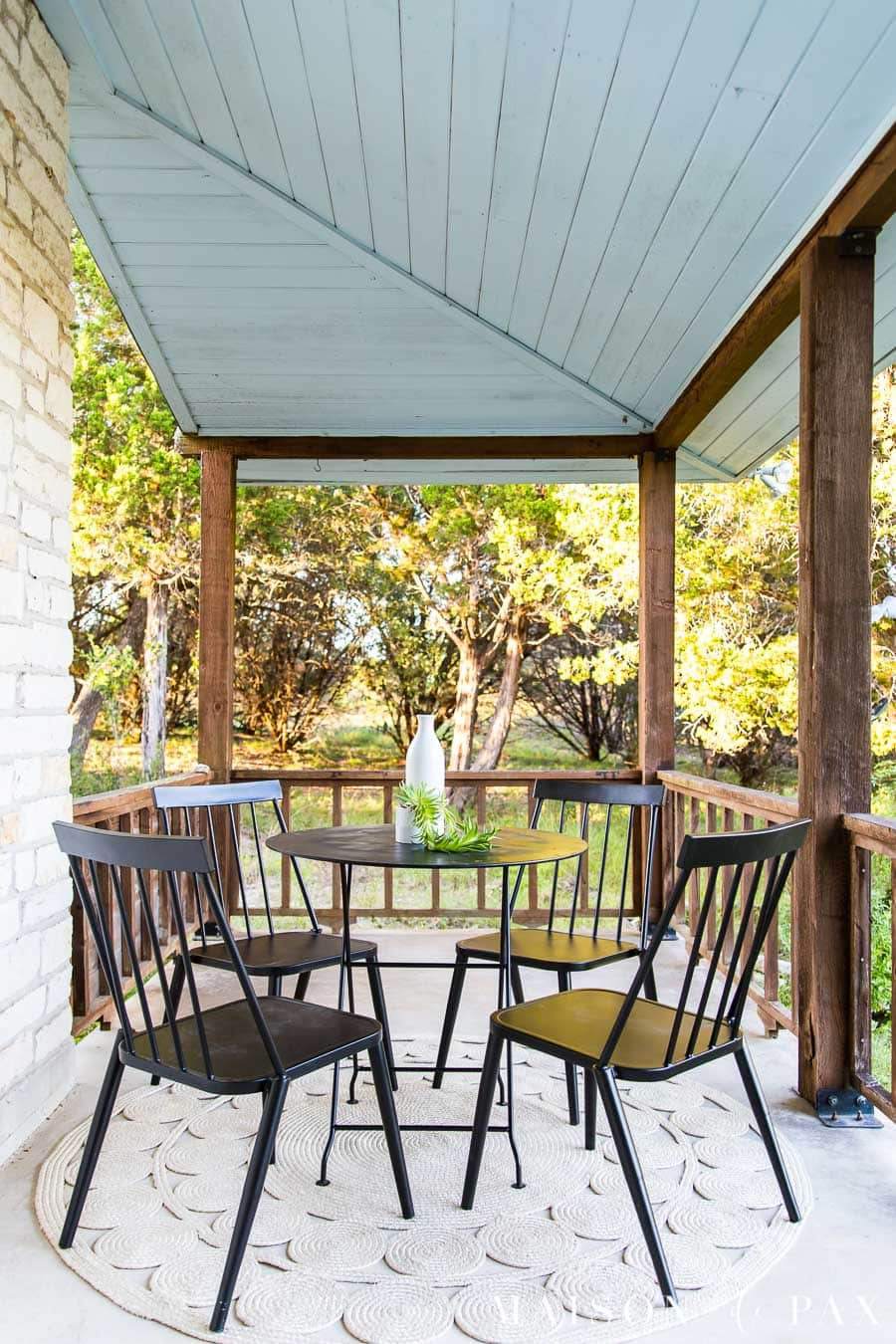 black metal outdoor chairs and bistro table on wrap around porch with haint blue ceiling | Maison de Pax