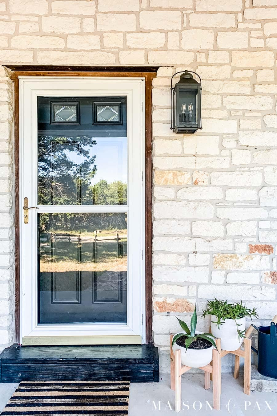black door, black porch light, and striped doormat on modern farmhouse porch | Maison de Pax