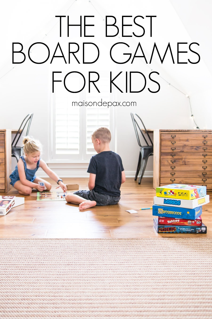 boy and girl playing board games on floor with overlay: the best board games for kids | maisondepax.com