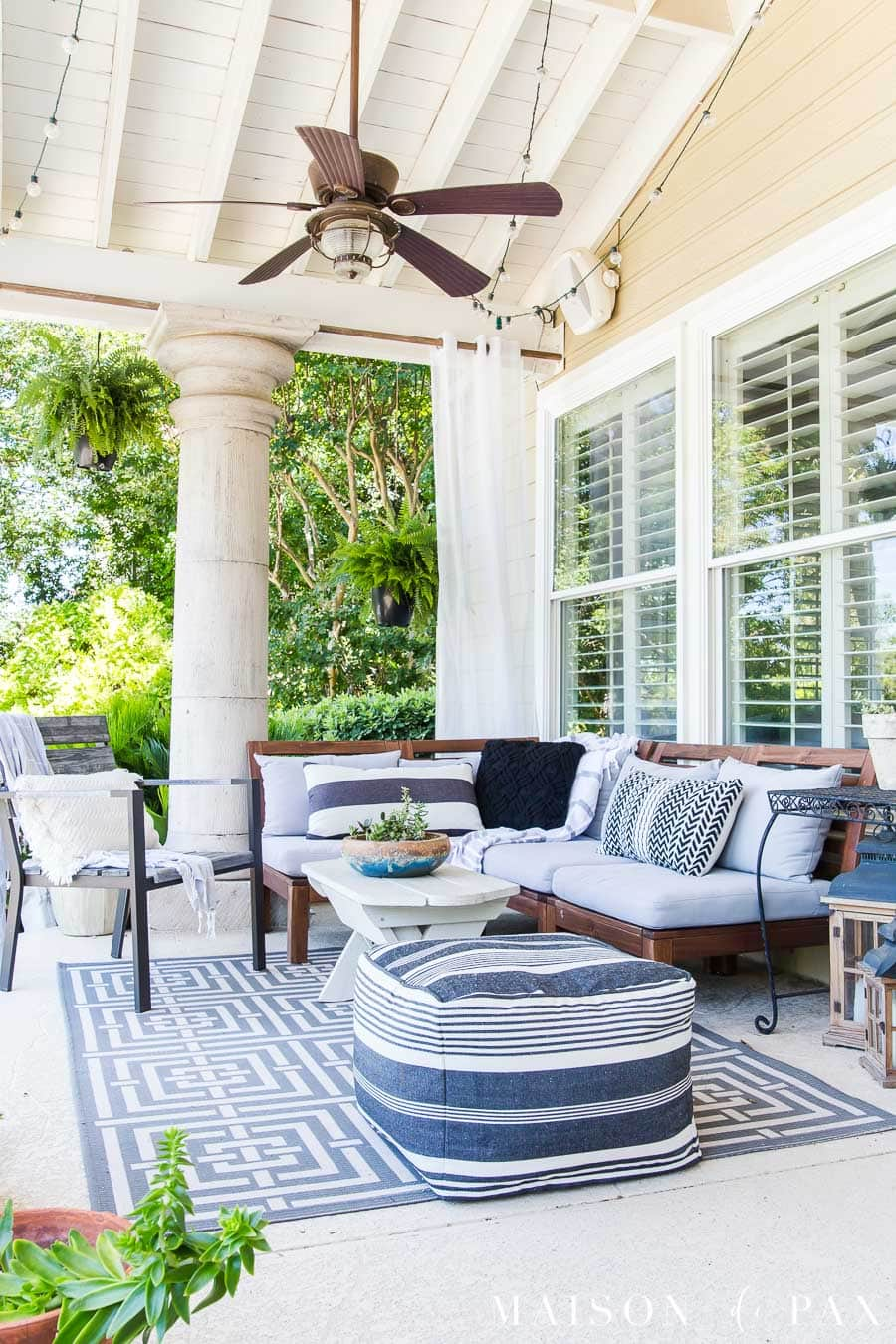 clean patio with wood and metal furniture decorated in black, white, and gray | Maison de Pax