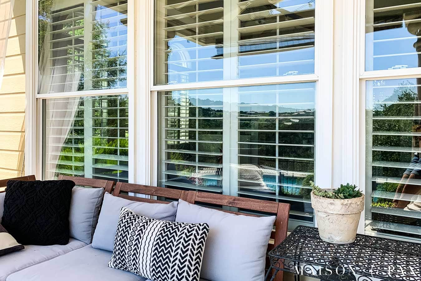clean patio windows behind outdoor sofa on back porch | Maison de Pax