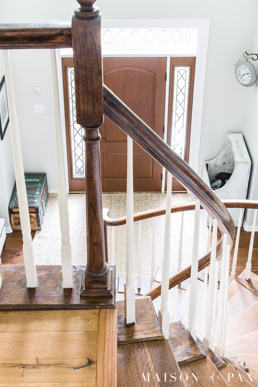 two story entryway and stairs with wood floors and light gray walls | Maison de Pax