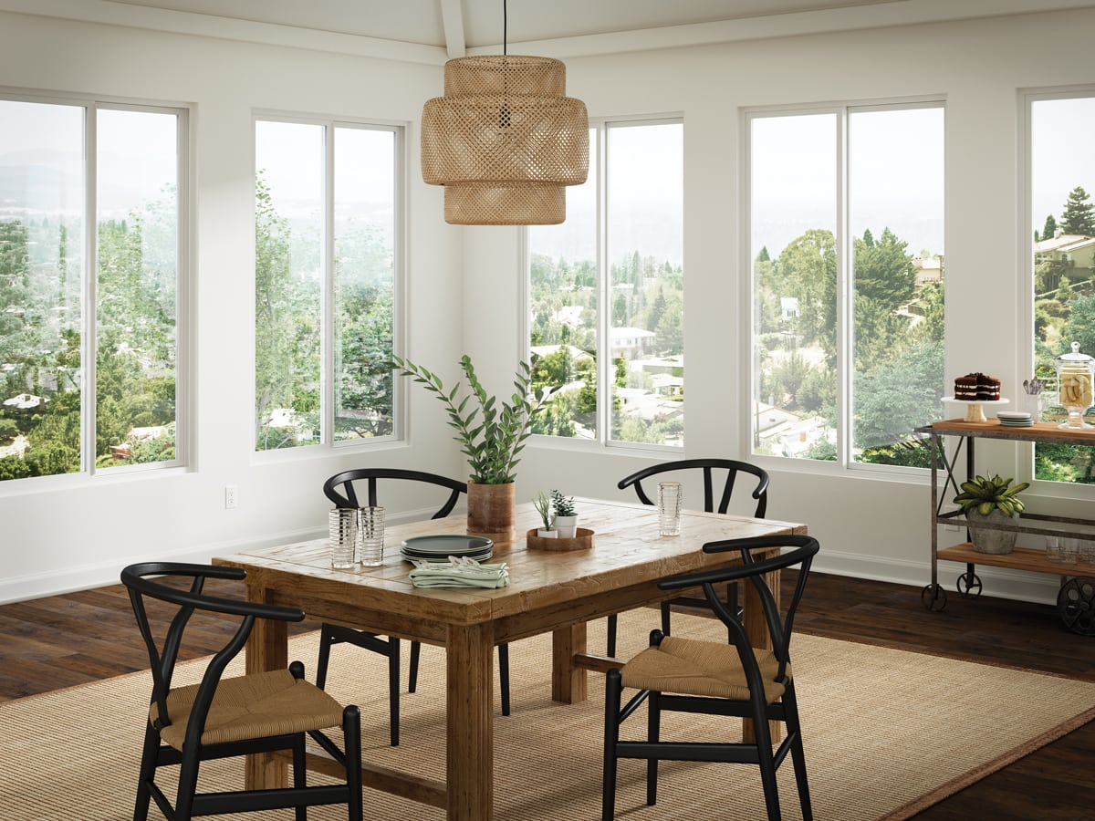 white dining room with beautiful views, modern elements, and rustic farm table | Maison de Pax