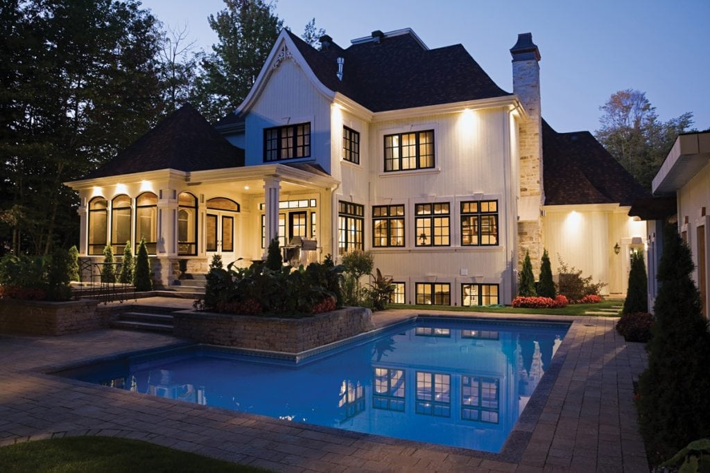 two story white home with big porch and black windows | Maison de Pax