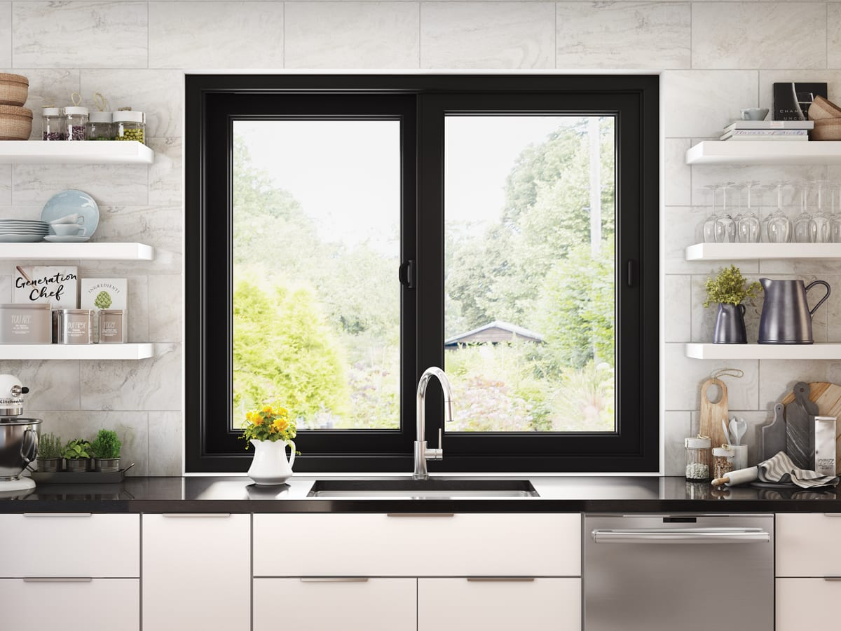 white kitchen with open shelving, black counters, and black window above sink | Maison de Pax