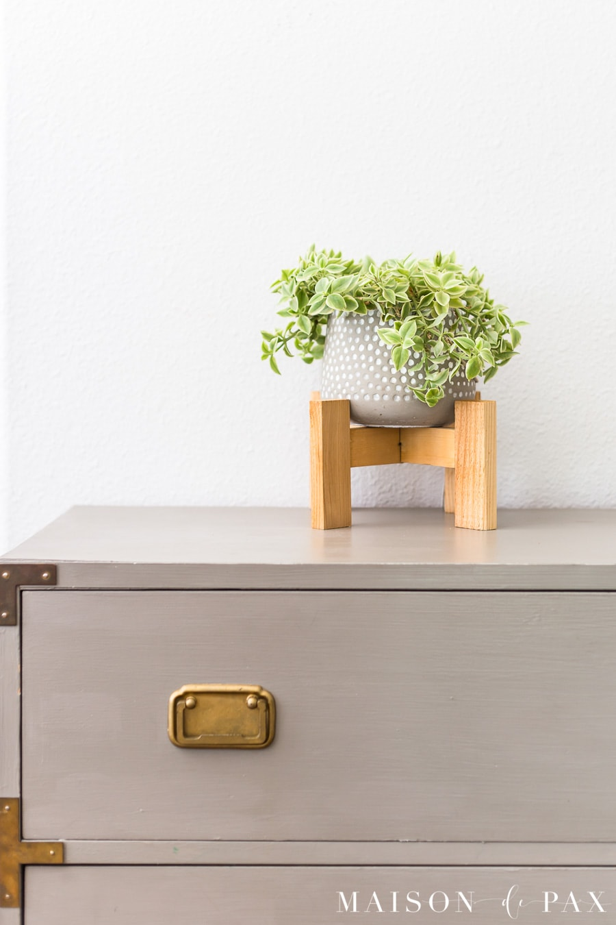 diy plant stand for small pot on top of gray campaign dresser | Maison de Pax