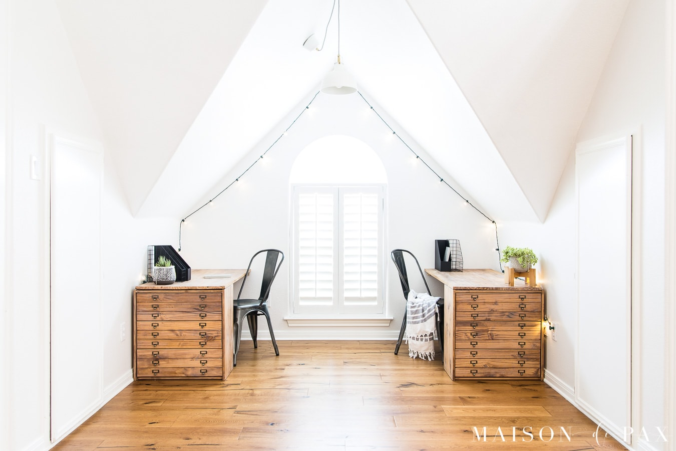 white room with wide plank rustic engineered oak flooring | Maison de Pax