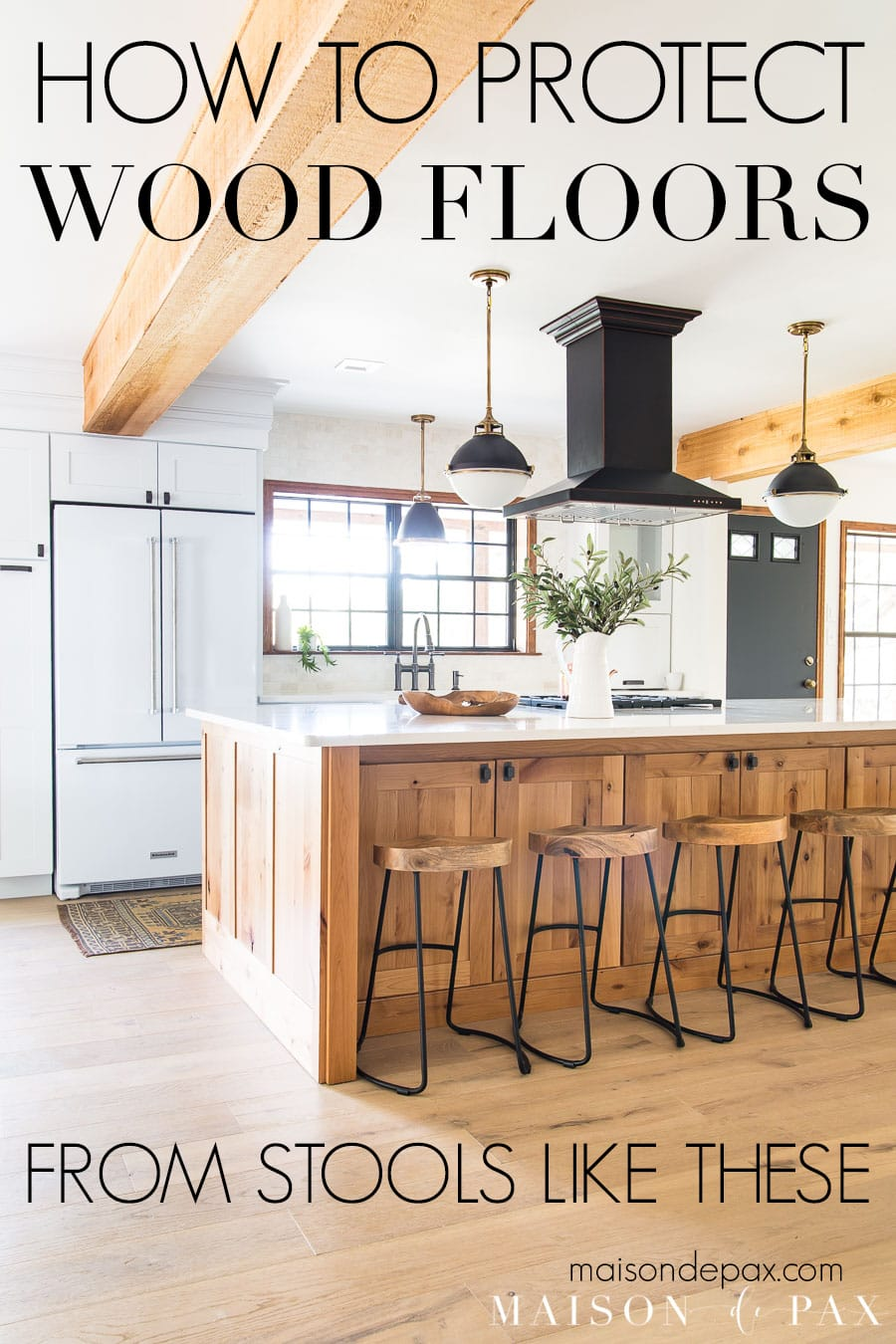 kitchen island with metal leg barstools and text overlay: how to protect wood floors from stools like these | Maison de Pax