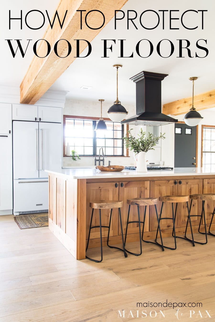 kitchen with light oak wood floors and text overlay: how to protect wood floors | Maison de Pax