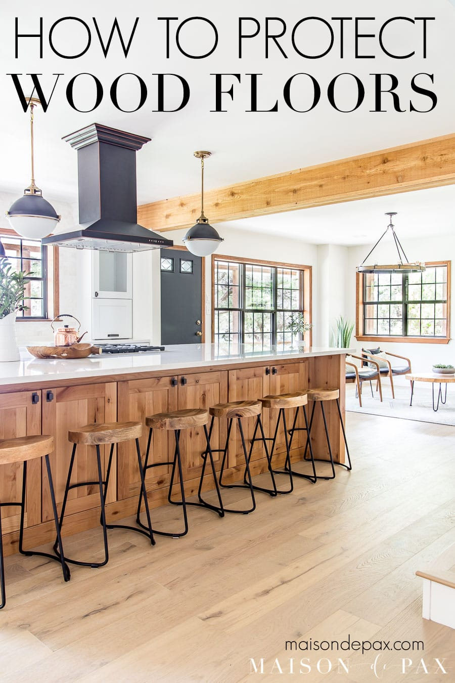 open living/kitchen with wood floors and text overlay: how to protect wood floors | Maison de Pax