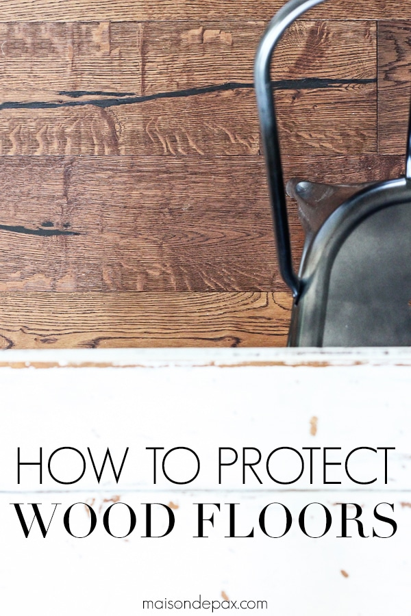 wide plank medium brown wood floors and metal chair with overlay: how to protect wood floors | Maison de Pax