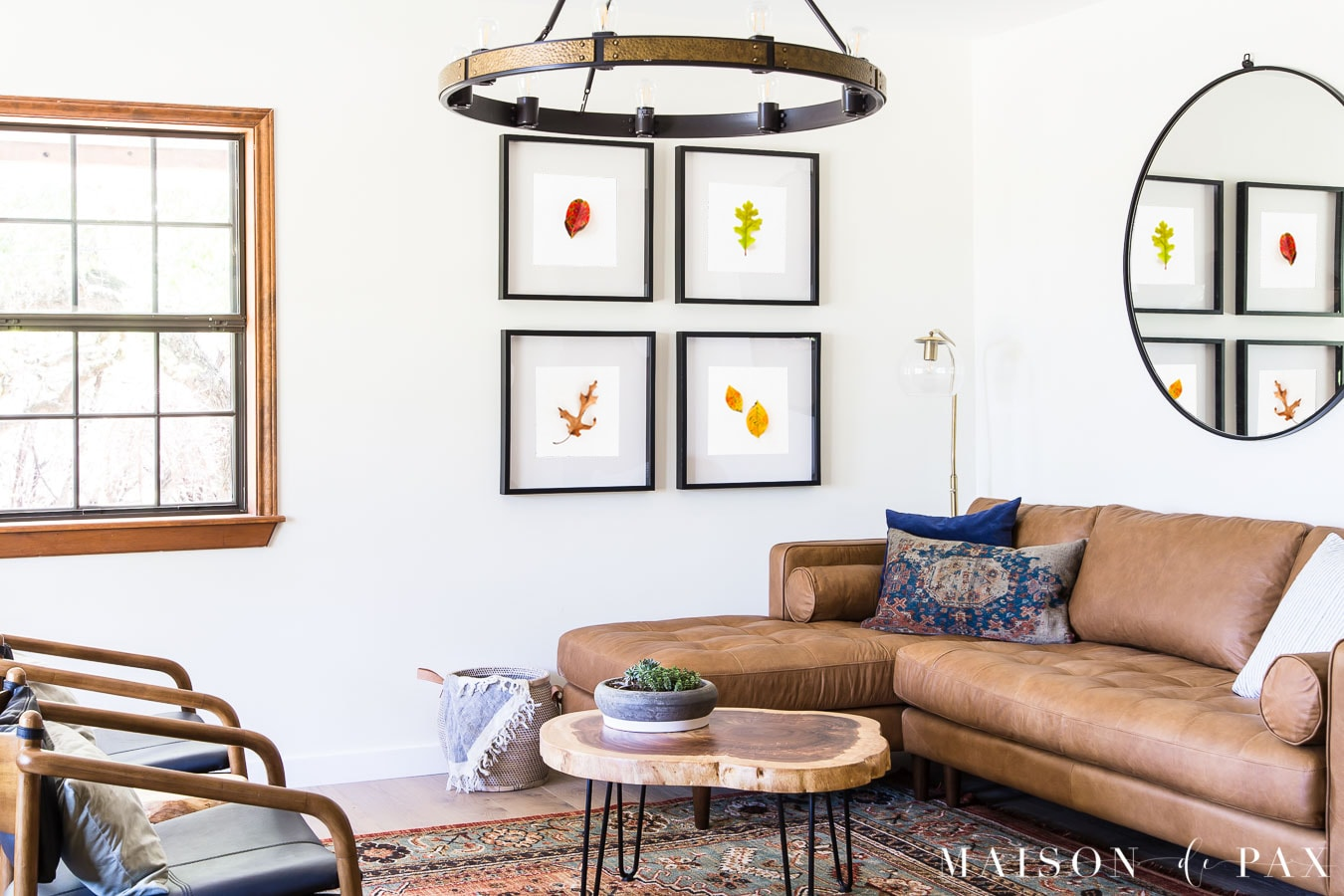 tan leather sofa, persian rug, and fall leaves as wall art   Maison de Pax